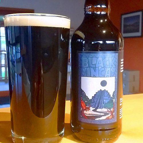 Black Inca in the glass beside 500ml bottle